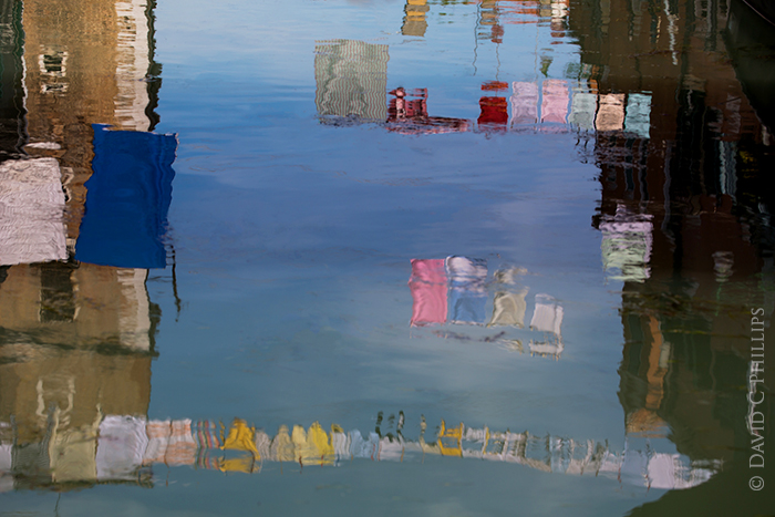reflections of laundry in Venice Italy