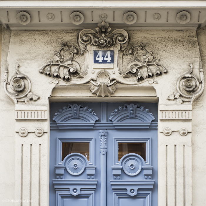 Ornate door, Paris, photographed by Georgianna Lane
